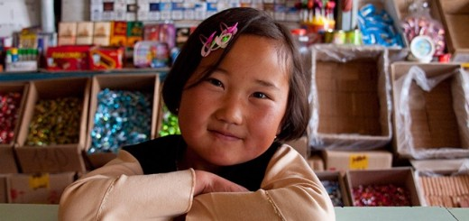 young girl shop keeper asia