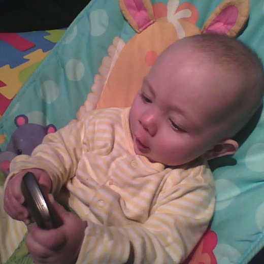 lily and phone Baby got tech: Todays children growing up in a world of gadgets