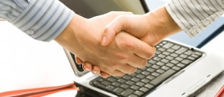 Successful handshake to seal a business deal in an office