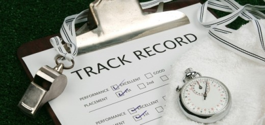 track record on clip board with stop watch, whistle and towel