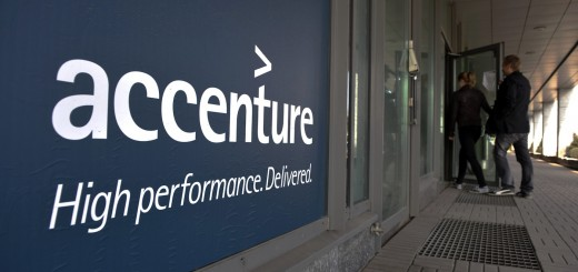 People enter an Accenture office in down