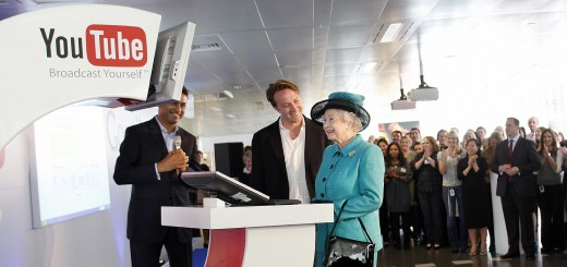 Britain's Queen Elizabeth II (R) uses a
