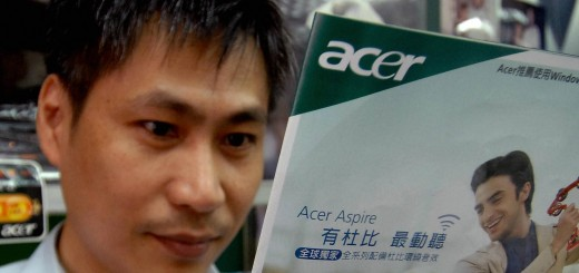 A man reads an Acer advertisement at a l