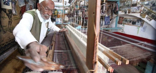 An elderly Libyan artisan produces tradi