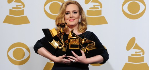 Musician Adele poses with her six trophi