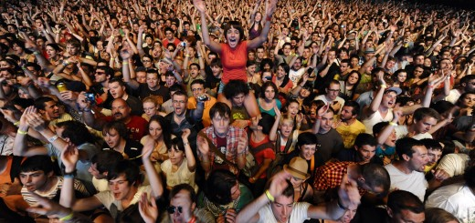 Festival goers cheer during a concert at