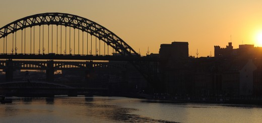 The sun sets behind the Tyne Bridge over