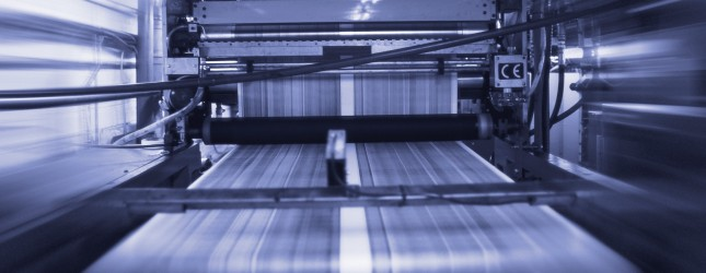 black and white time lapse view of a running printing press