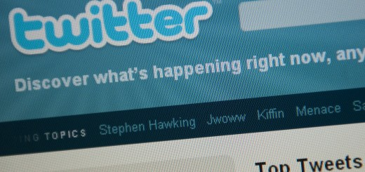The Twitter homepage appears on a screen