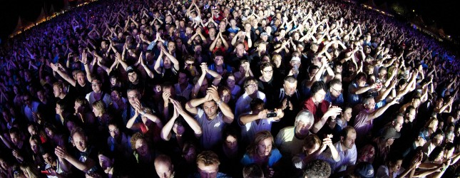 People attend the Simple Minds concert a