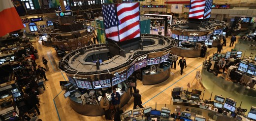 Traders Work On Floor On New York Stock Exchange As Fed Chair Bernanke Speaks