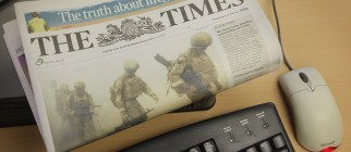 Newspaper Online Sites Consider Charging Users