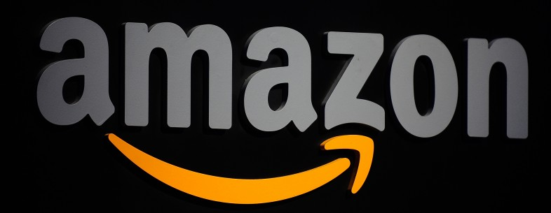 The Amazon logo is seen on a podium duri