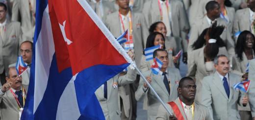 Athlete Mijain Lopez (C) Cuba's flag bea