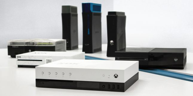 Microsoft's Project Scorpio dev kit (center), along with older Xbox models' dev kits